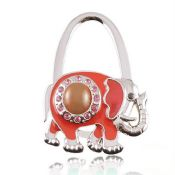 Fashion elephant shaped metal foldable bag hanger,table top bag hanger images